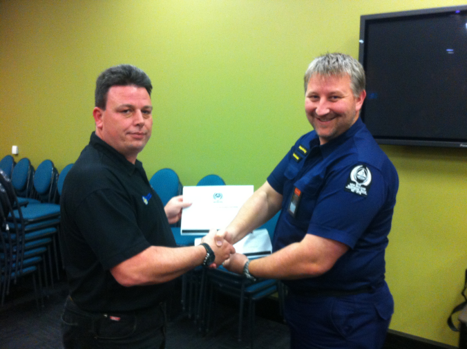 New NZ-RT Steering Committee Chairman Darryn Irving (right) presenting the outgoing Chairman Brandon Guttery with a certificate of appreciation.