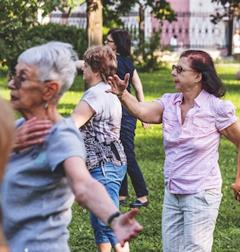 Older adults exercise in a park.