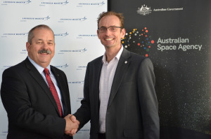Rod Drury, Managing Director Australia and NZ Lockheed Martin Space (left) and Anthony Murfett, Acting Head Australian Space Agency mark the official signing. Civic Reputation
