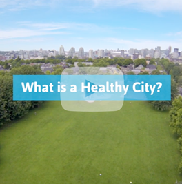 """The cover of the """"What We Heard"""" report, featuring the Province of BC logo and an aerial photo of a small BC town."""
