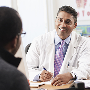Physician taking notes during conversation