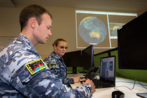 Leading Aircraftwoman Nerissa Walpole and Leading Aircraftman Rob Patterson discuss space debris patterns.