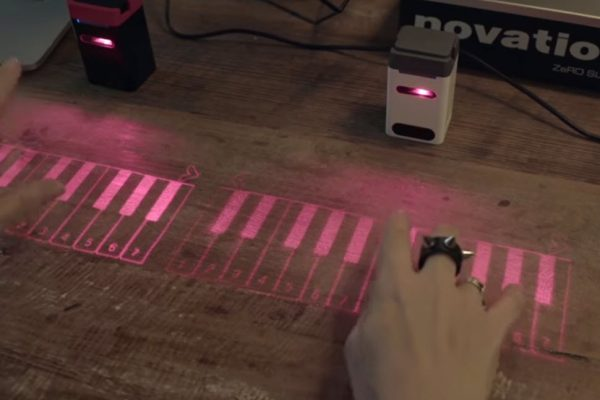 THIS MAGIC BOX TURNS ANY SURFACE INTO A VIRTUAL KEYBOARD OR PIANO