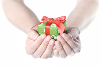 Hands holding a wrapped Christmas present