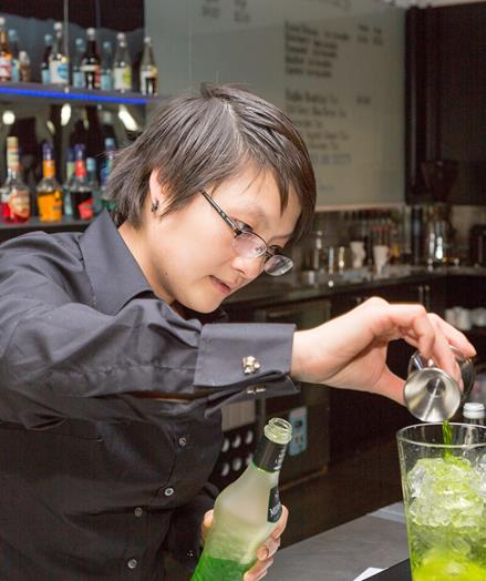 Image of Becky Chin creating a cocktail