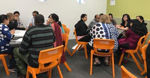 People sitting around desks for workshop