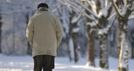 Older man walking outdoors in winter