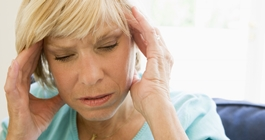 Older woman holding head in pain