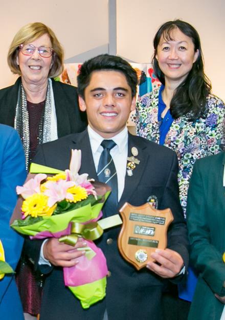 Image of the winner Te Ariki Te Puni with Berlinda Chin in the background