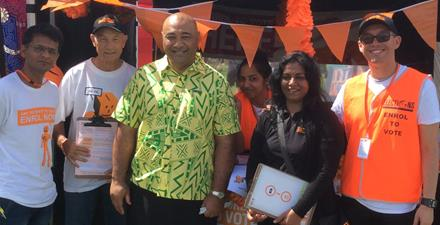 Image of the Minister for Ethnic Communities Hon Peseta Sam Lotu-Iiga  in front of the Electoral Commission stand