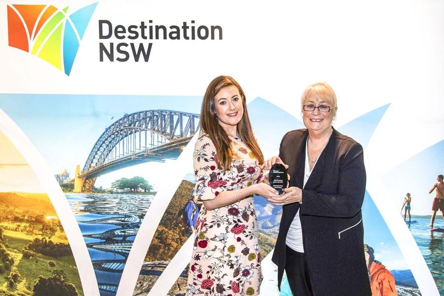 Destination NSW Chief Executive Officer, Sandra Chipchase, and Expedia Media Solutions Senior Business Development Manager for Australia and New Zealand, Lisa Whitelaw, presenting the award for 'Australia & New Zealand Campaign of the Year'