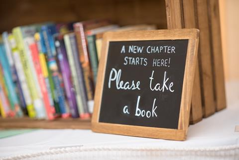 Please take a book sign
