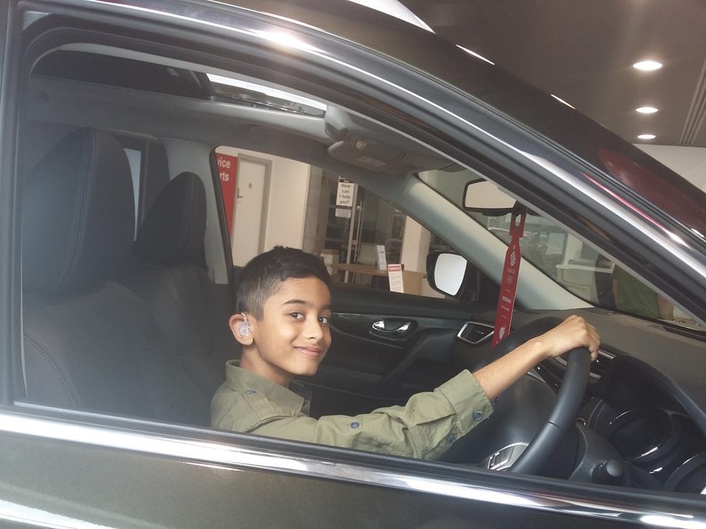 Photo - Shazar behind the steering wheel of a car!