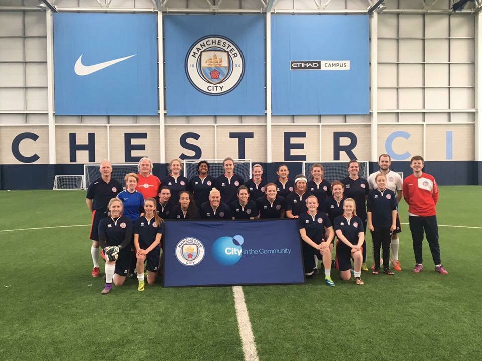 Felicity Morris (second row on left, in blue) training at Manchester City Football Club