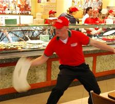 Flying pizza pie guy entertains at MKE food court