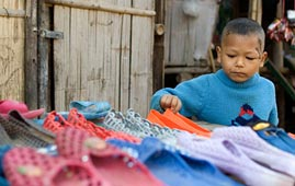 Refugee child at shoe stall on the Thailand-Myanmar border