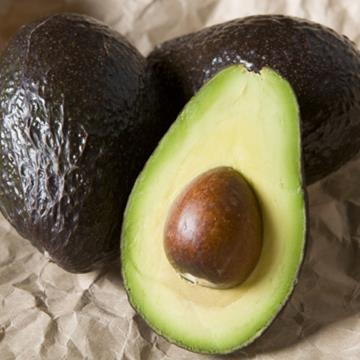 Three avocados; one sliced.