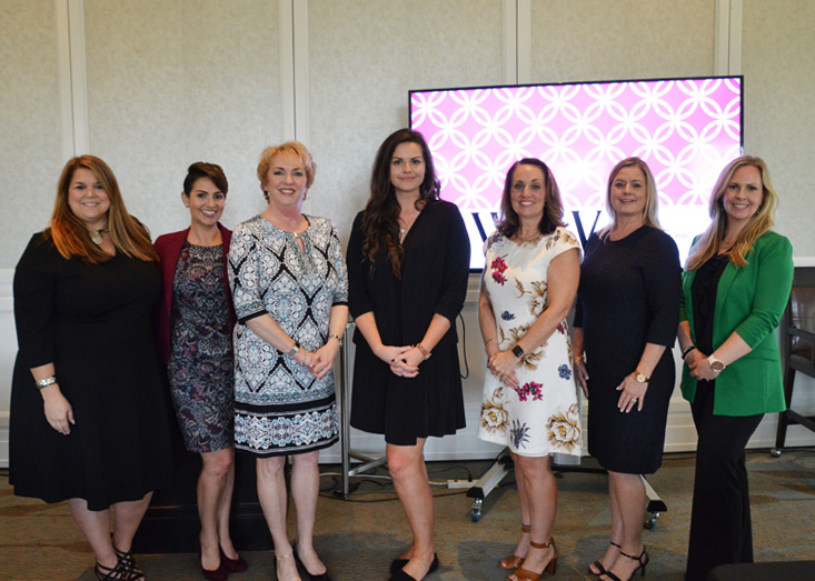 A group of seven women, including Shannon R. Chessman and Darlene Malaney, at the Women's Leadership Panel at the Club at Ibis