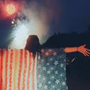 woman wearing US flag shirt