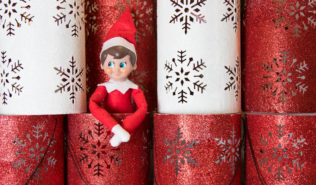 Elf hiding in wrapping paper