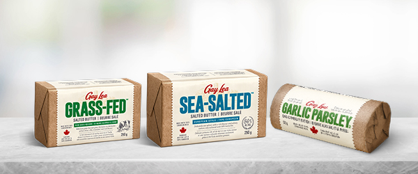 Gay Lea Specialty Butter packages: Grass-Fed Salted butter, Sea Salted butter, and Garlic Parsley butter.