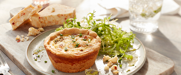 Mini ham cheese quiche served with a small garden salad with Pepper jack cheese on the side.