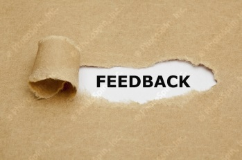 Ripped brown paper and the word 'feedback' behind the tear
