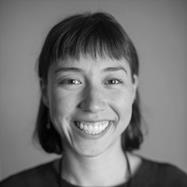 Small black and white image of advocacy director Kelsey Mesher