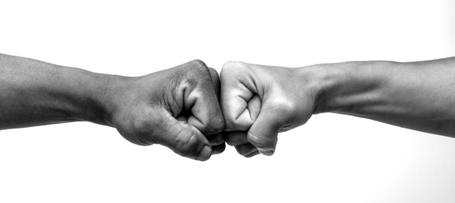 Man giving fist bump, monochrome, black and white image.