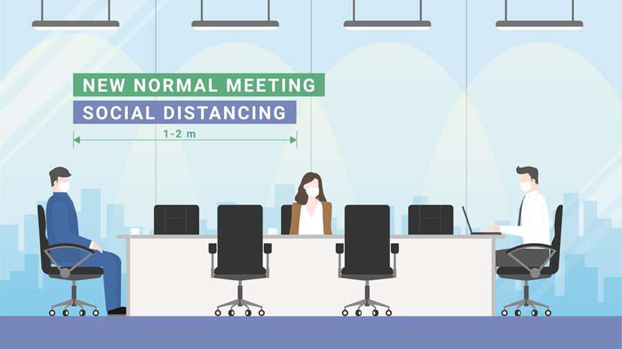 Business meeting lifestyle after pandemic covid-19 corona virus. New normal is social distancing and wearing mask. People keeping distance in office conference room.