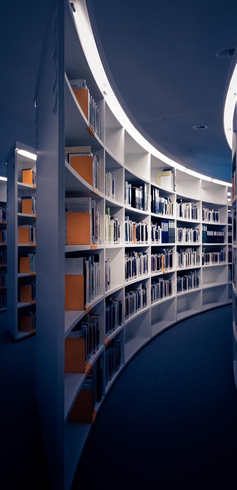 Modern book shelves in library