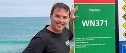 Image of Rick Gerring, Ben Gerring's brother, with the Claytons Beach BEN sign
